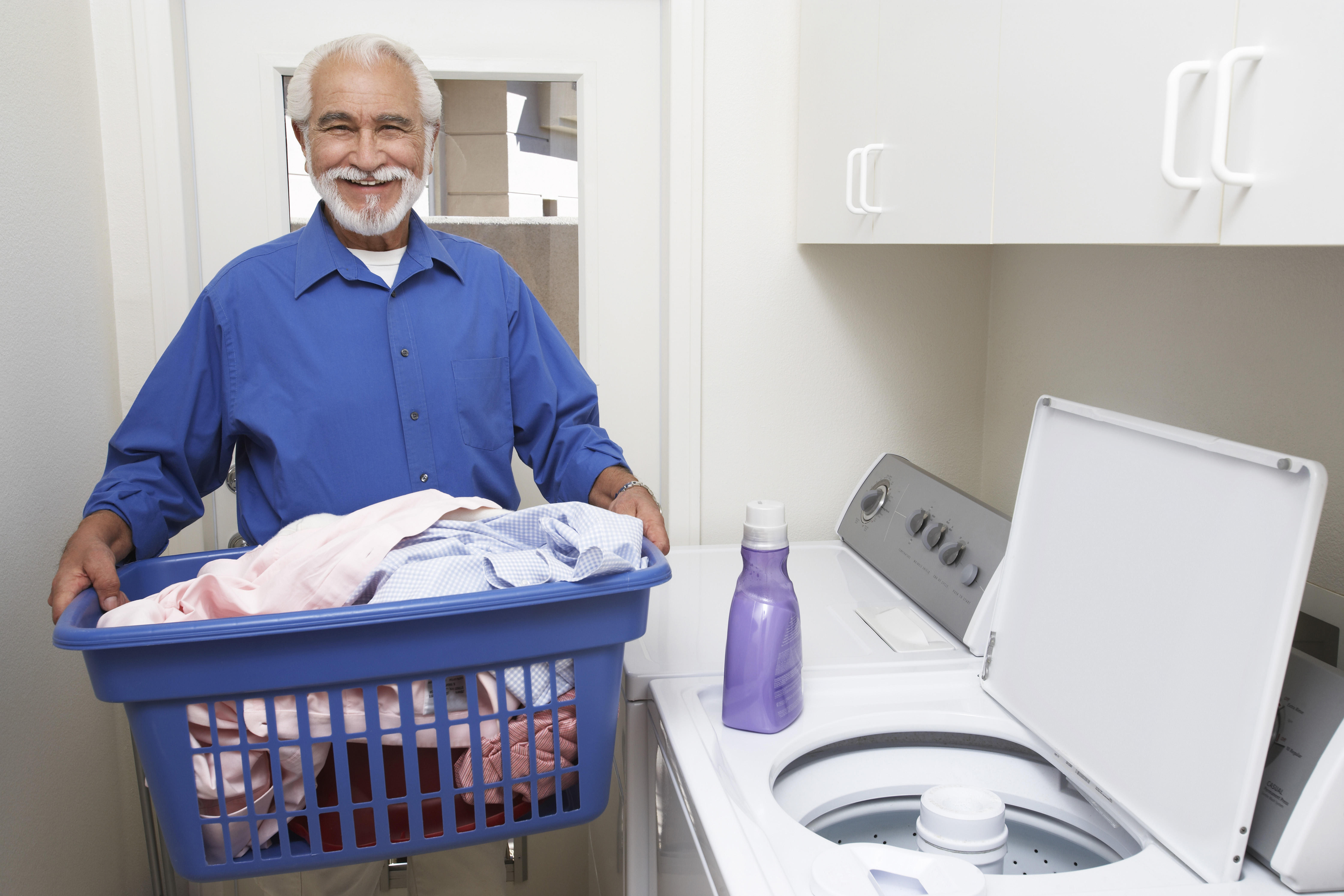 Adjusting the laundry settings to save on energy costs.